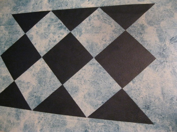 Larger squares on second floor cloth....